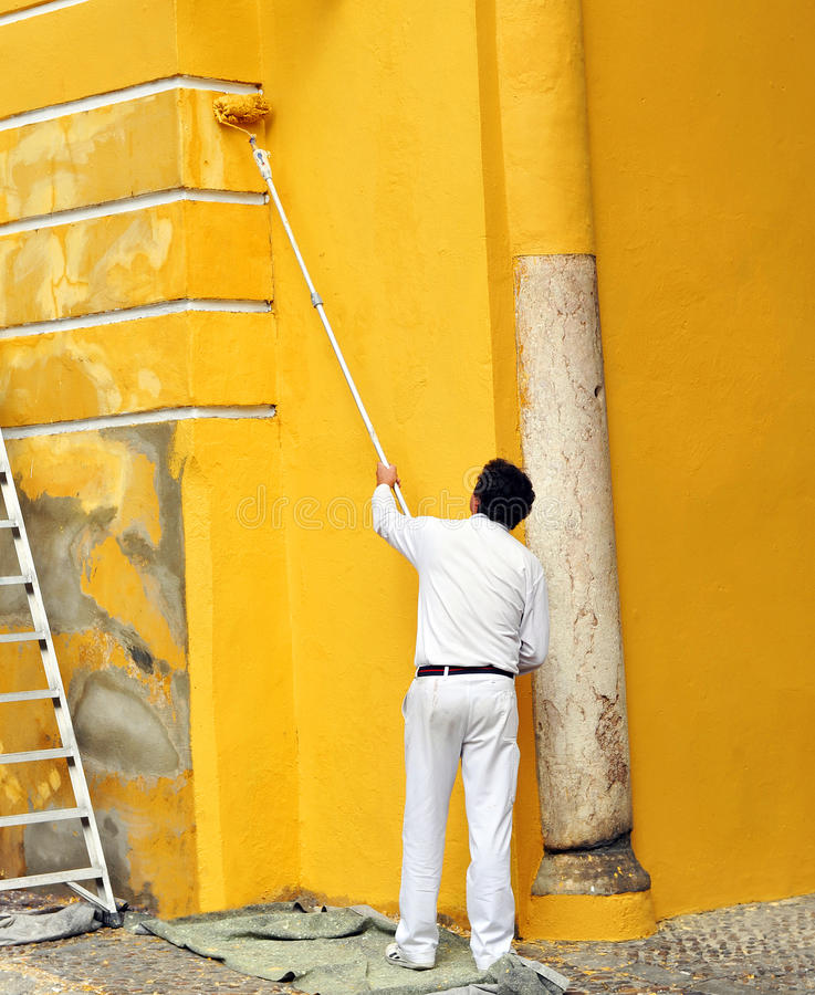 painter-painting-facade-ancient-buildind-roller-spain-maintenance-work-monument-seville-66412870